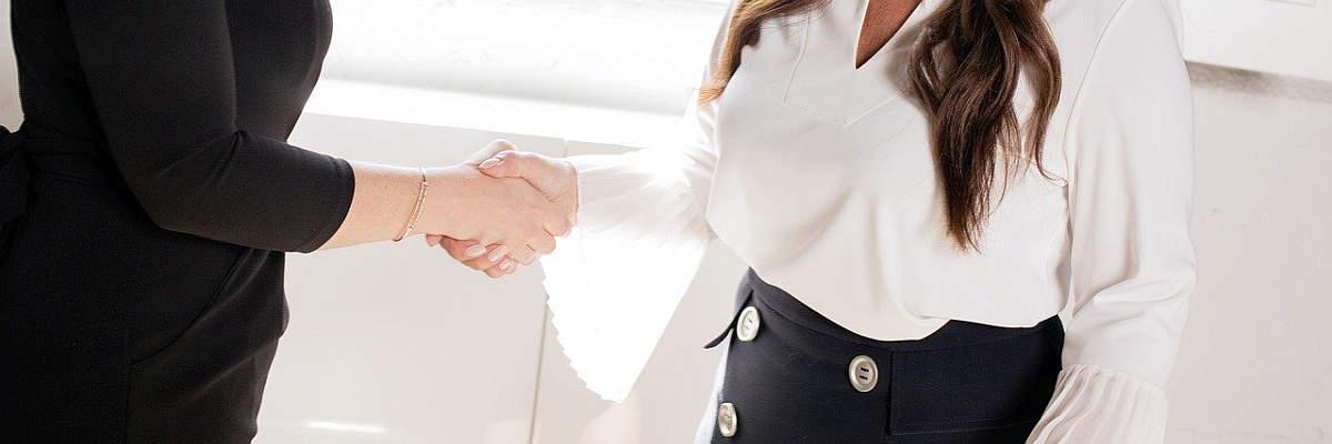 handshake two women